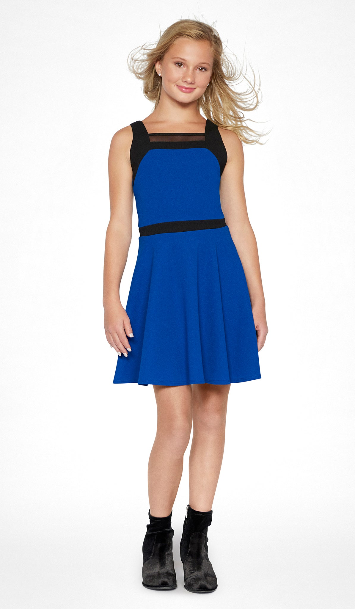 Sally Miller tween royal fit and flare knit special occasion dress with black trim and mesh insert front view.