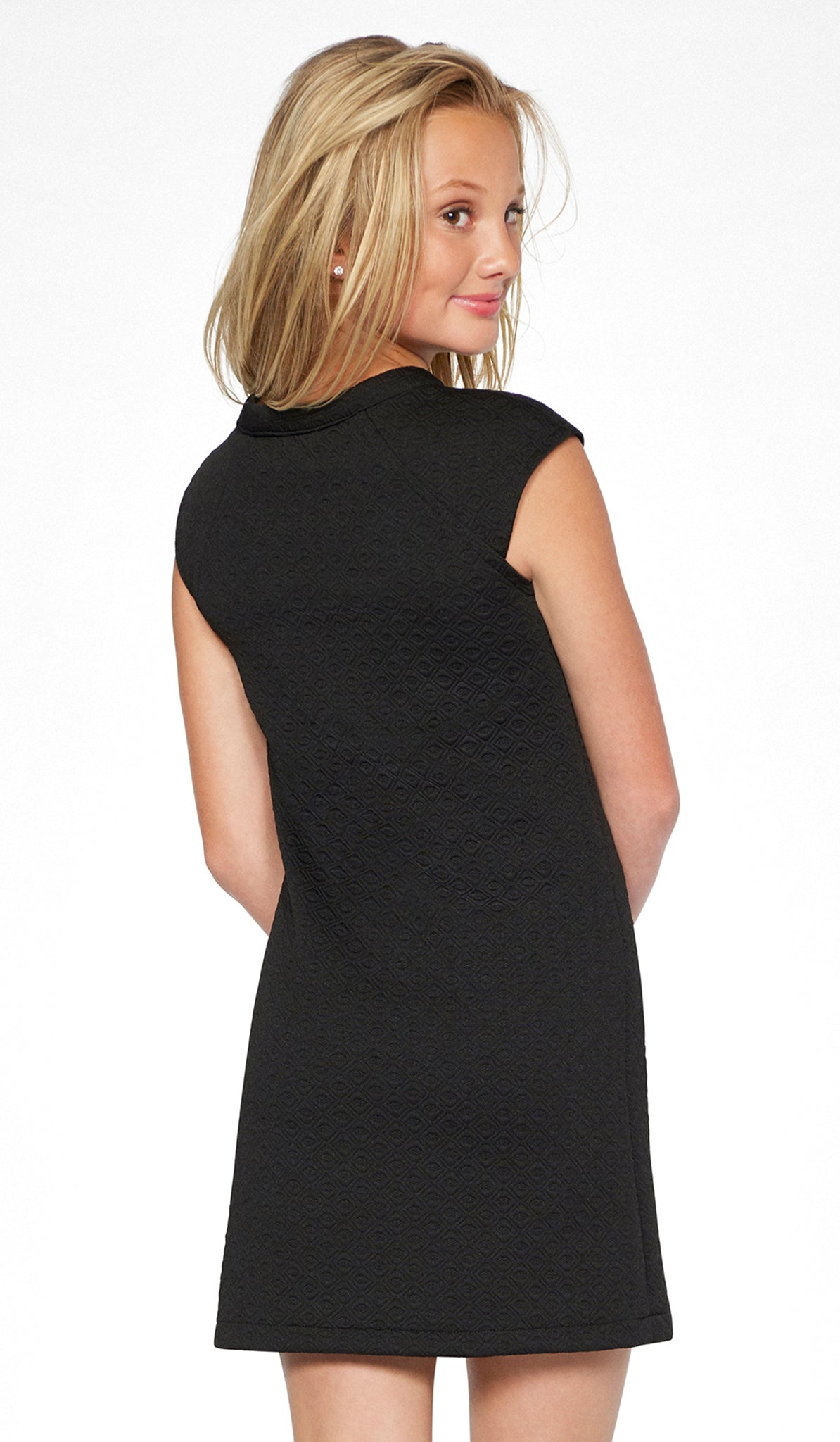 Sally Miller tween black and ivory shift knit special occasion dress back view..