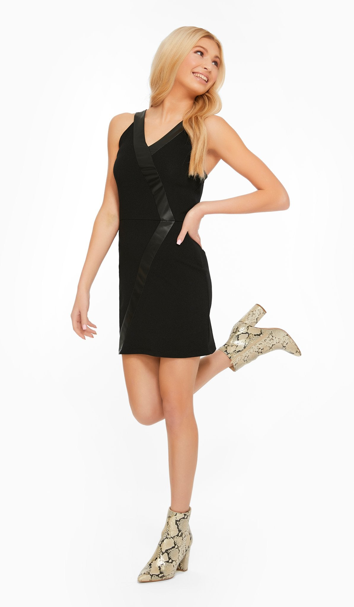 The Sally Miller Tuxedo Dress (Juniors) - Black stretch textured knit A-line dress with vegan leather trim detail and side zipper