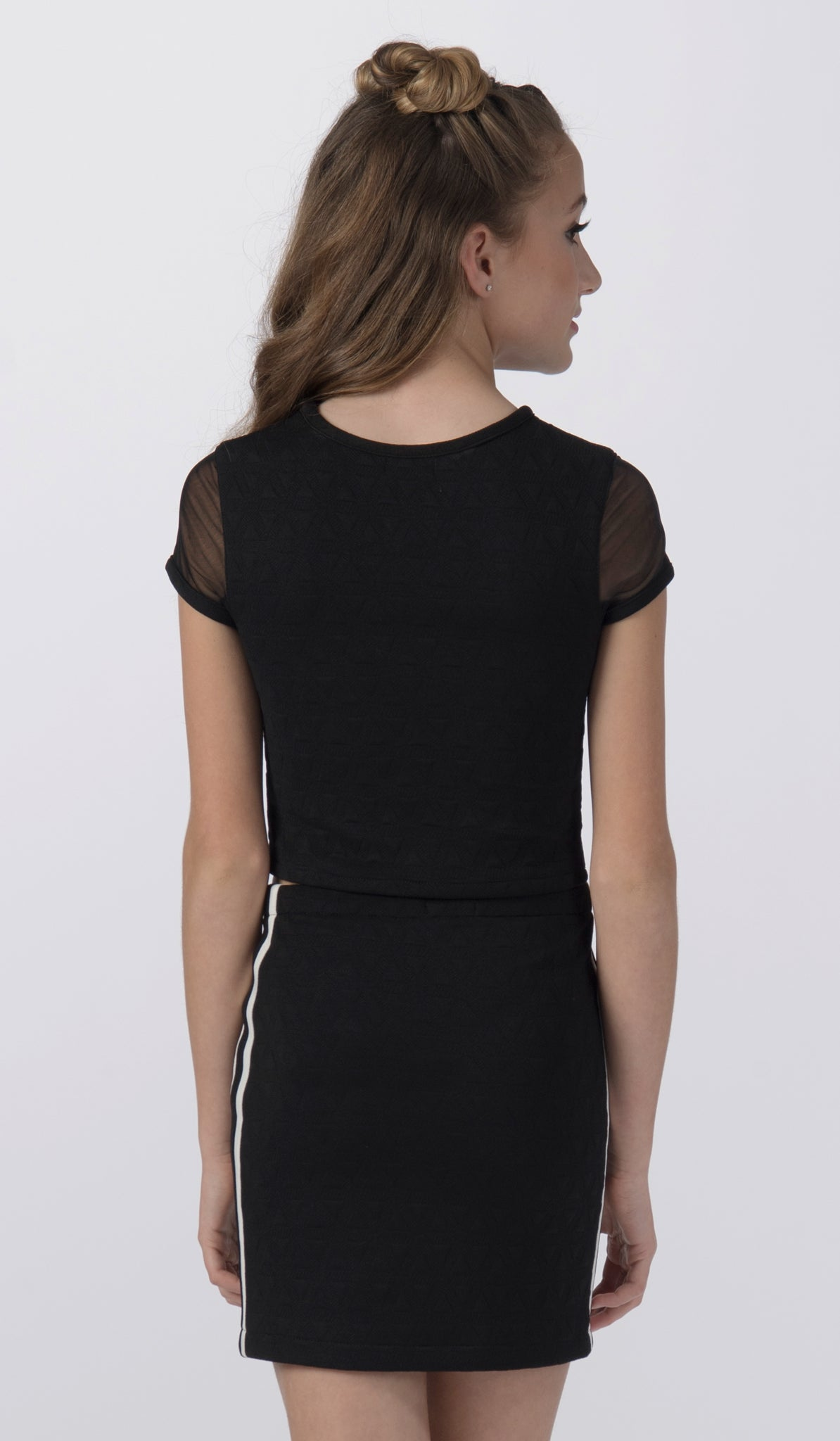 Sally Miller black stretch knit two piece set back view.