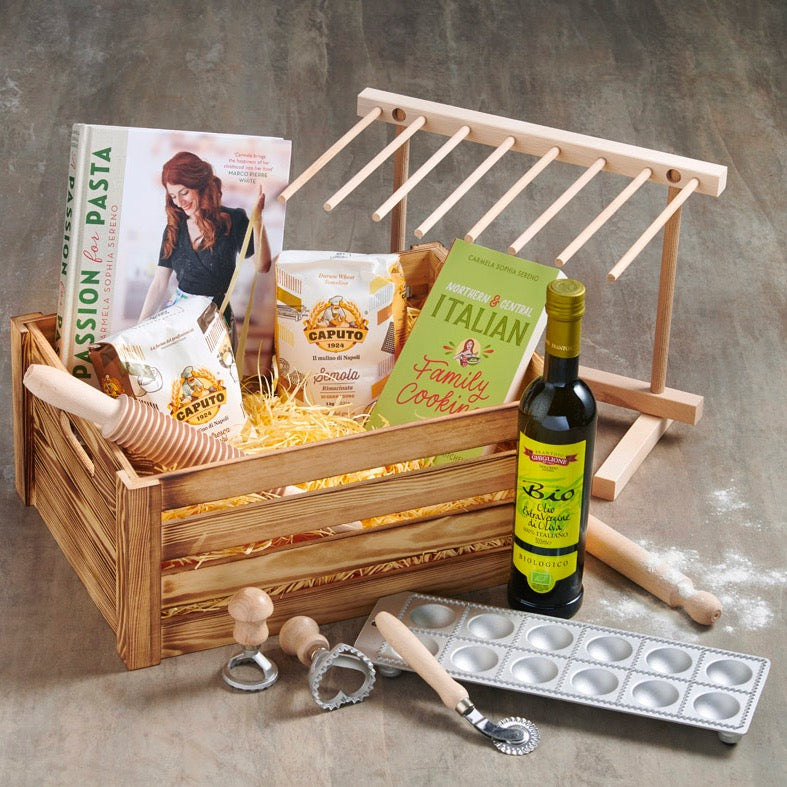 Pasta making hamper with cookery book, flour, olive oil and utensils.