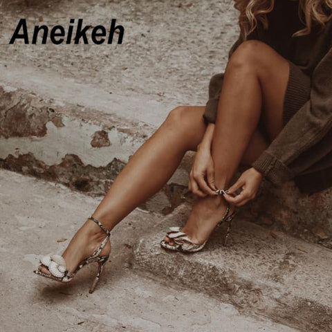 Aneikeh 2019 New Fashion Sexy Butterfly-knot Buckle Thin High Heels Black Faux Suede Open Toe Gladiator Dress Sandals Lady Shoes