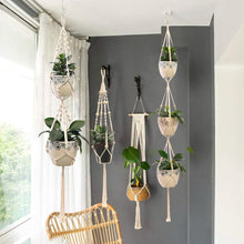 Load image into Gallery viewer, Our Macramé Plant Hangers are a great way to save space in your home and keep flower pots off the floors and shelves.  These hanging nets can suspend your beautiful potted plants while adding an elegant style and greenery to your room.