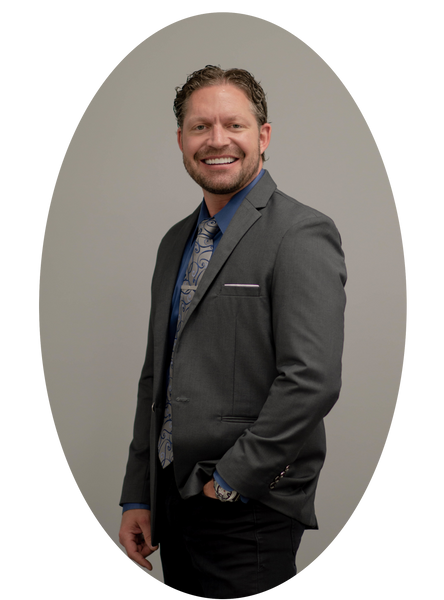 Founder & CEO, Dennis M. Postema smiling in a suit