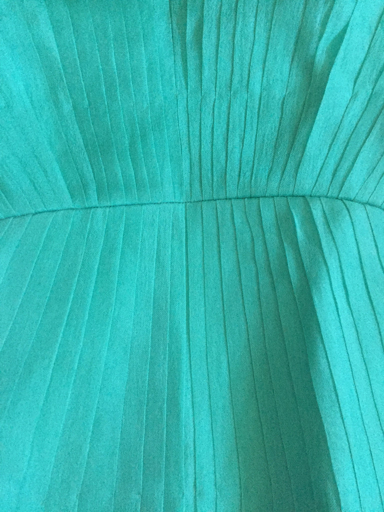 handstitched handcrafted pure organza silk dress with low back in turquoise