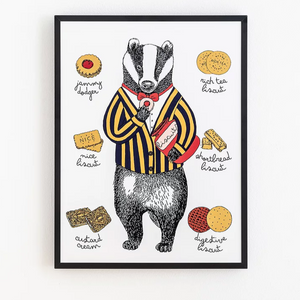 Print in a black frame and white background. The illustration is of a badger in suit and bowtie holding biscuits surrounded by smaller illustrations of different types of biscuits.