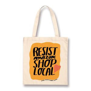 Tote bag with black text on a yellow background with orange heart. the text reads : 'resist amazon, shop local'