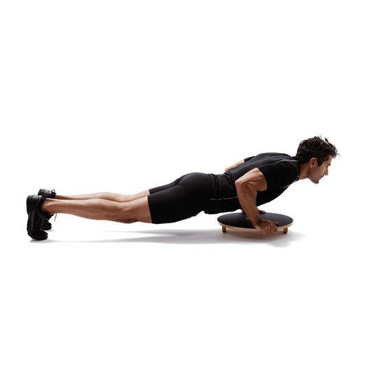 Core exercises on a balance board