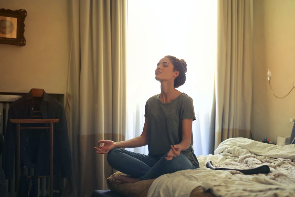 woman-meditating-while-listening-to-music