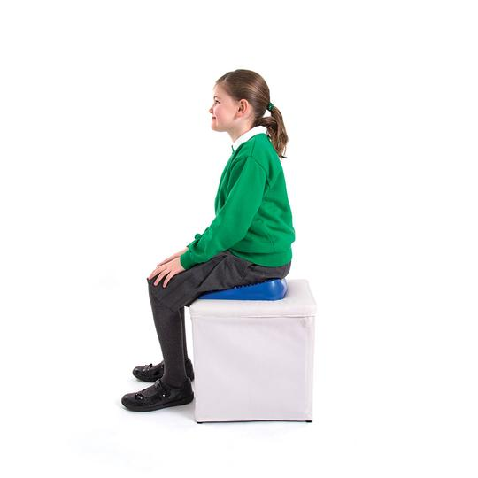 Child sitting on wedge cushion