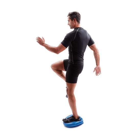Standing on wobble cushion