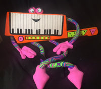 blacklight keytar puppet walk about