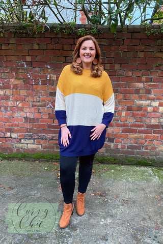 mustard yellow and navy jumper dress with wooden circle earrings