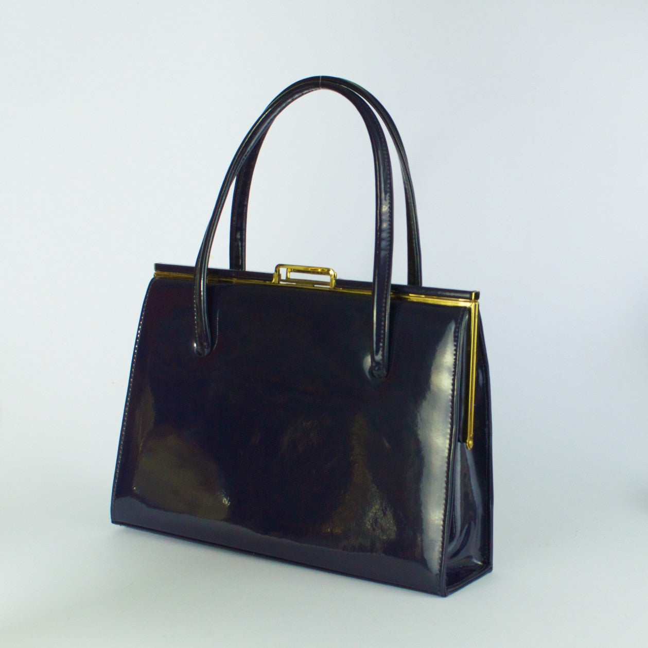 Vintage navy patent leather handbag by Ackery