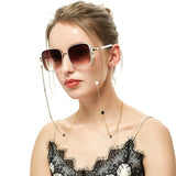 girl with sunglasses chain