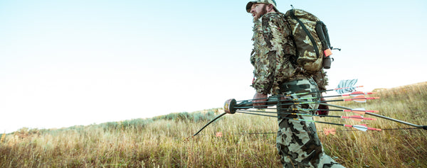 Man in camouflage with arrows and a backpack