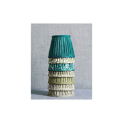 stack of green patterned lampshades