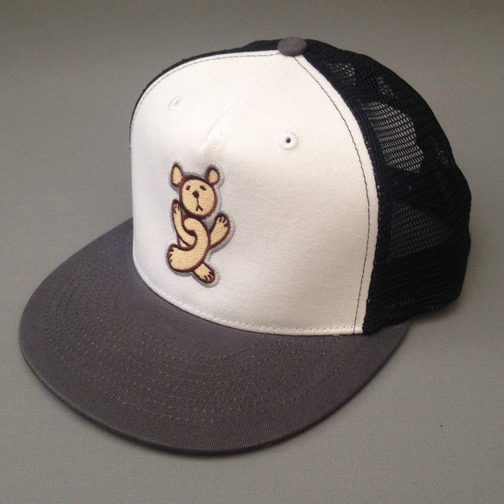 Twisted Teddy contrast mesh snapback cap.