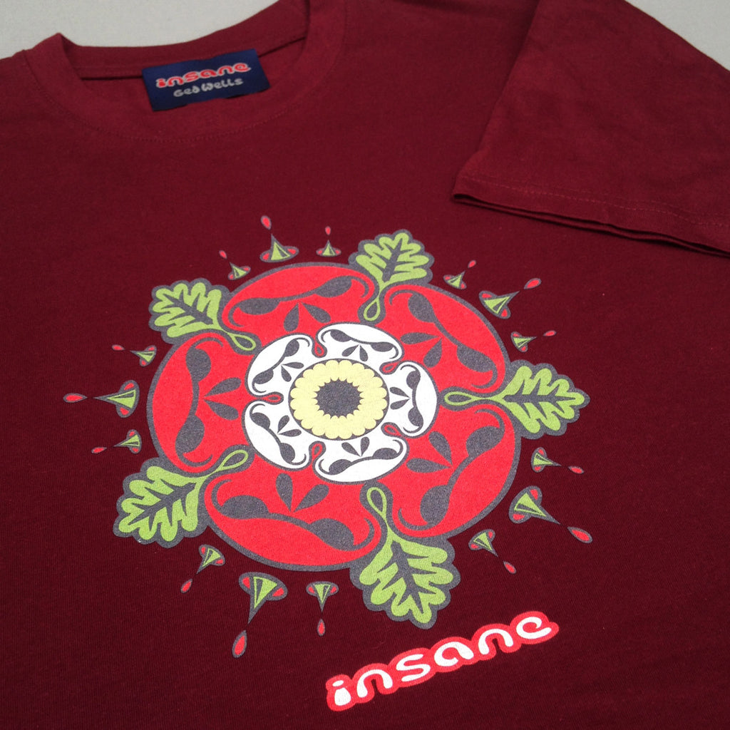 Tudor Rose Skulls on burgundy T shirt.