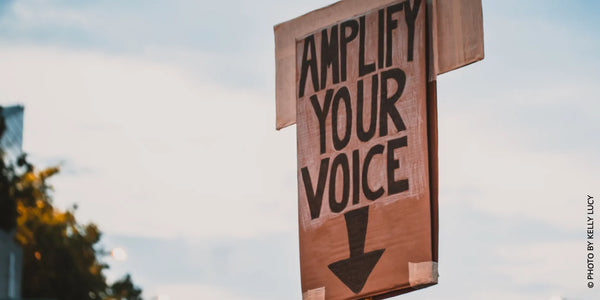 Sign with amplify your voice during protest