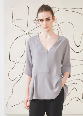 Dagg & Stacey Harbor Blouse.  Light grey v-neck blouse with 1/2 sleeve.