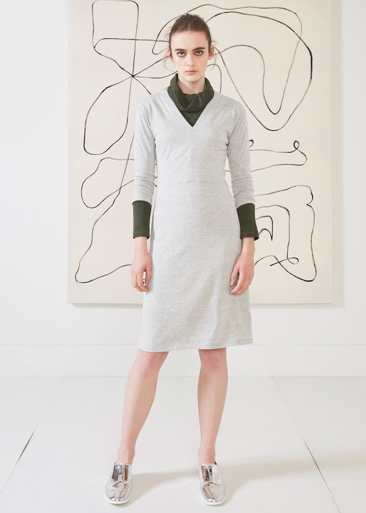 Dagg & Stacey Munro Dress.  Light grey body con dress with V-neck and 3/4 length sleeves.