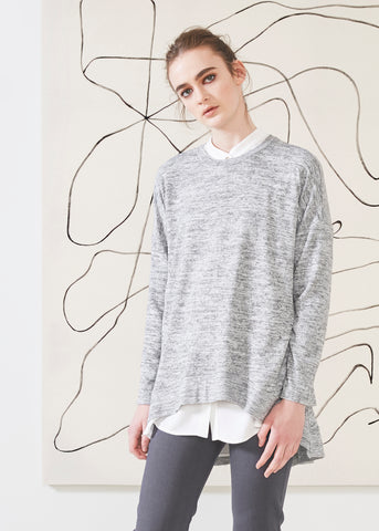 Dagg & Stacey Pilar Sweatshirt.  Light grey drop sleeve crew next sweater with curved hem.