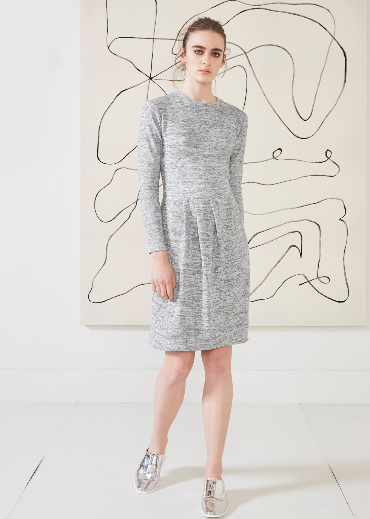 Dagg & Stacey Yardley Dress.  Light grey long sleeve crew neck dress with asymmetrical front pleat.