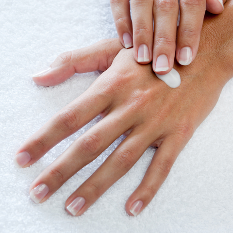 Applying hand lotion as a skincare treat