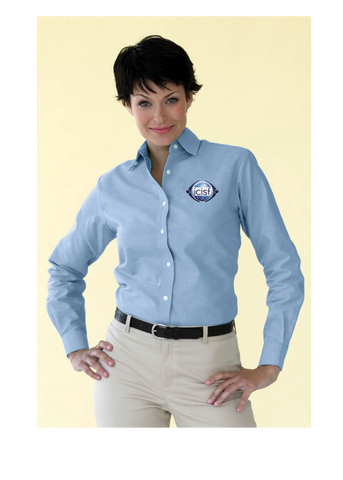 Confident woman in early 30s shows the light blue oxford shirt looks sharp with with a pair of khakis and simple belt
