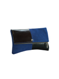 Esoteric clutch in cobalt blue suede and black leather with matte nickel hardware, side view