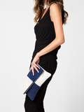 Esoteric clutch in cobalt blue suede and ivory leather with nickel hardware, on the body