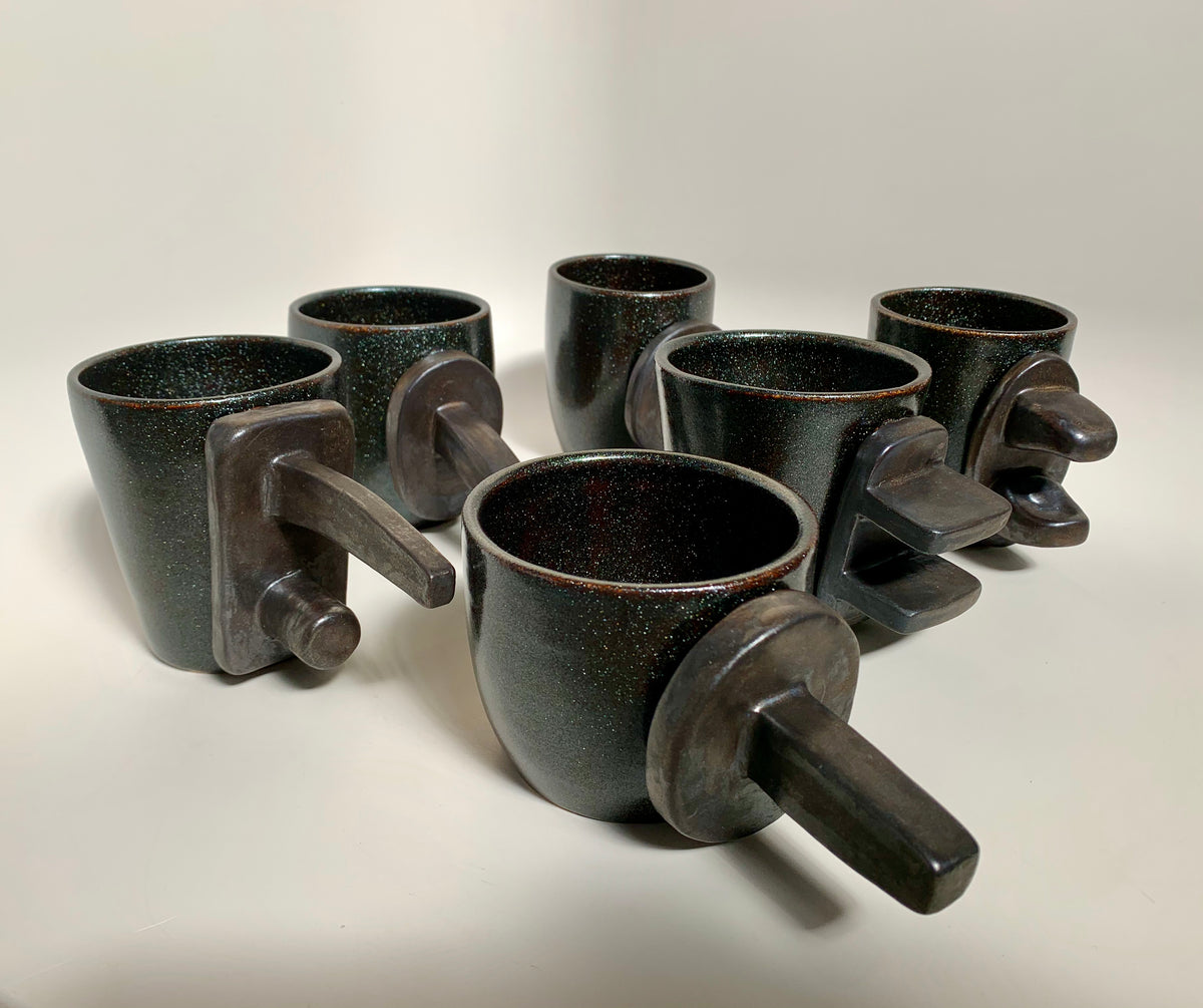 The Rikow Collection, handmade ceramic vessels for coffee or tea in galaxy and bronze color way by artist Stef Duffy