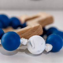 Load image into Gallery viewer, Close up of marble white Our Father bead on baby rosary teething ring