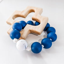 Load image into Gallery viewer, Blue and white marble silicone teething ring with wooden cross teether