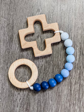 Load image into Gallery viewer, Rosary teething strand in blue ombre with wooden cross and ring teethers