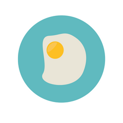 Teal plate with egg sunny side up