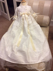 Lace and silk christening gown.