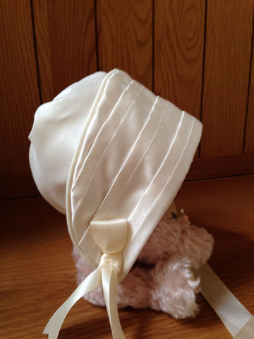 The Eden unisex christening bonnet.