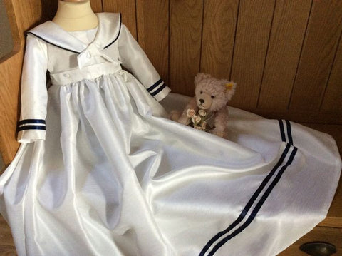 The Admiral sailor style christening gown with removable skirt.