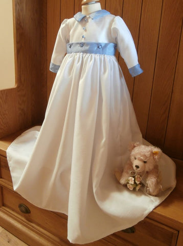 The Edward boys christening gown with pale blue trim.