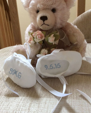 Personalised, embroidered christening bootees. In and out.
