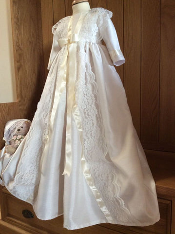The Victoria girls christening gown in satin and lace.