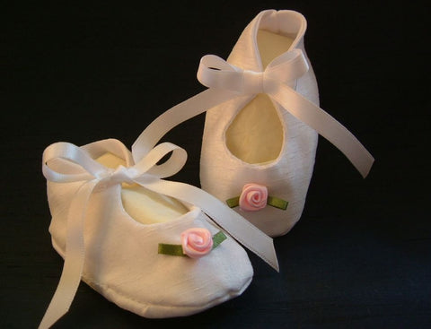 Rosebud christening bootees in silk or satin.