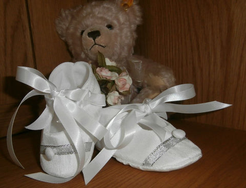 Christening slippers, button and silver trim.