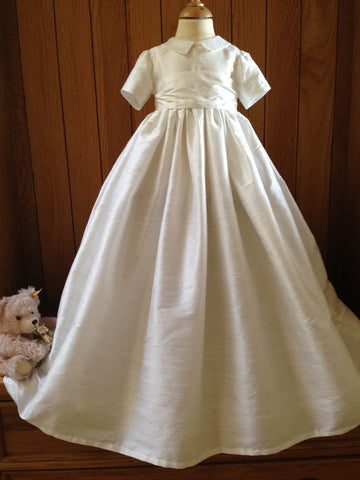 The Venice silk christening gown with waistband and bow.