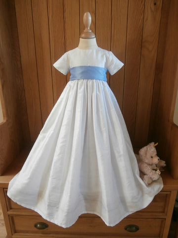 The Paris silk christening gown with blue sash.
