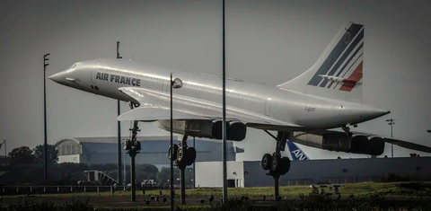 An Air France airplane lifting off from the tarmac.
