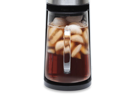A sleek electric glass kettle. The kettle is filled with iced tea.