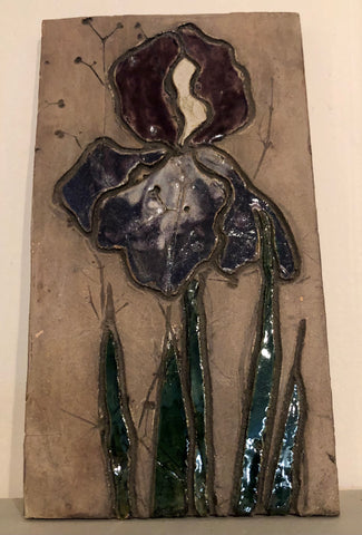 A purple and red glazed iris flower relief carving.